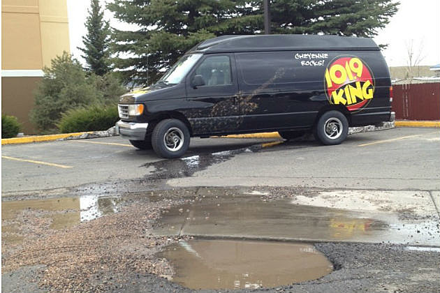 King Van Parked Near Large Pothole
