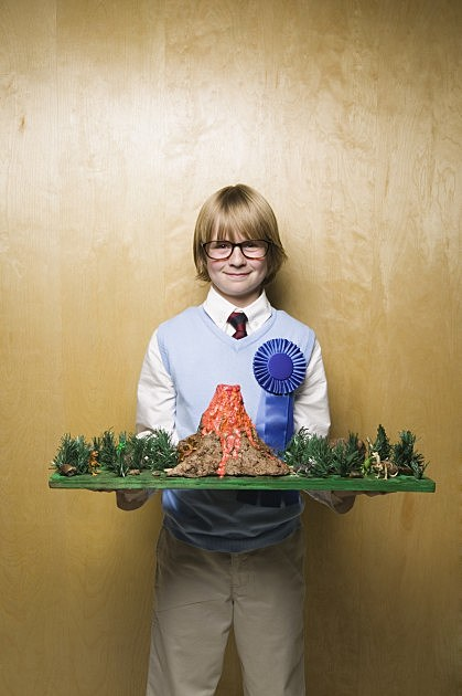 Science Fair Boy with Model Volcano-Credit-Digital Vision