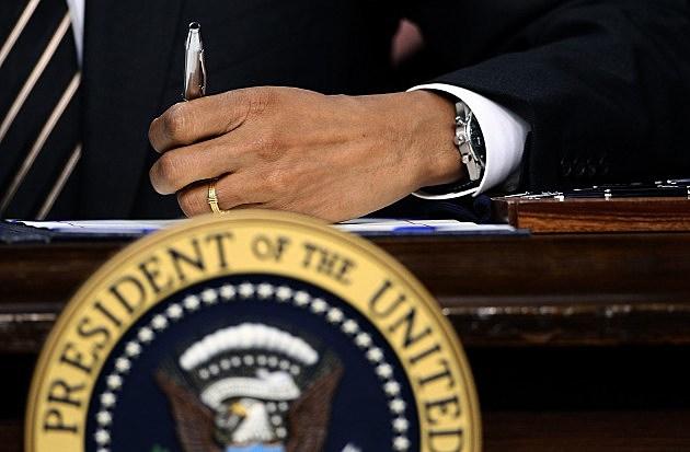 President Obama Signs Bill 2012