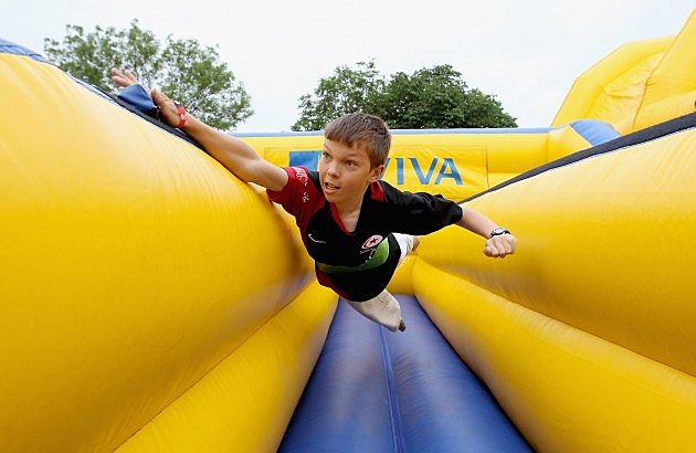 Kid Playing on an Inflatable