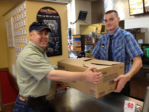 Gary Freeman Recieving Big Chicken Fillets from Carl's Jr Asst Mgr Adam Anderson