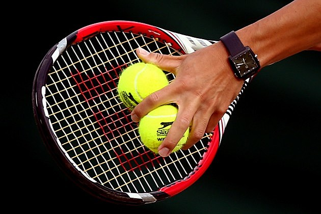 Tennis Balls on Raquet