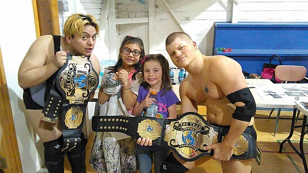 Big Sky Wrestling Tag Team Champs Jeff Orcut and Adan Reyes pose with the fans. Photo Courtesy of Big Sky Wrestling.