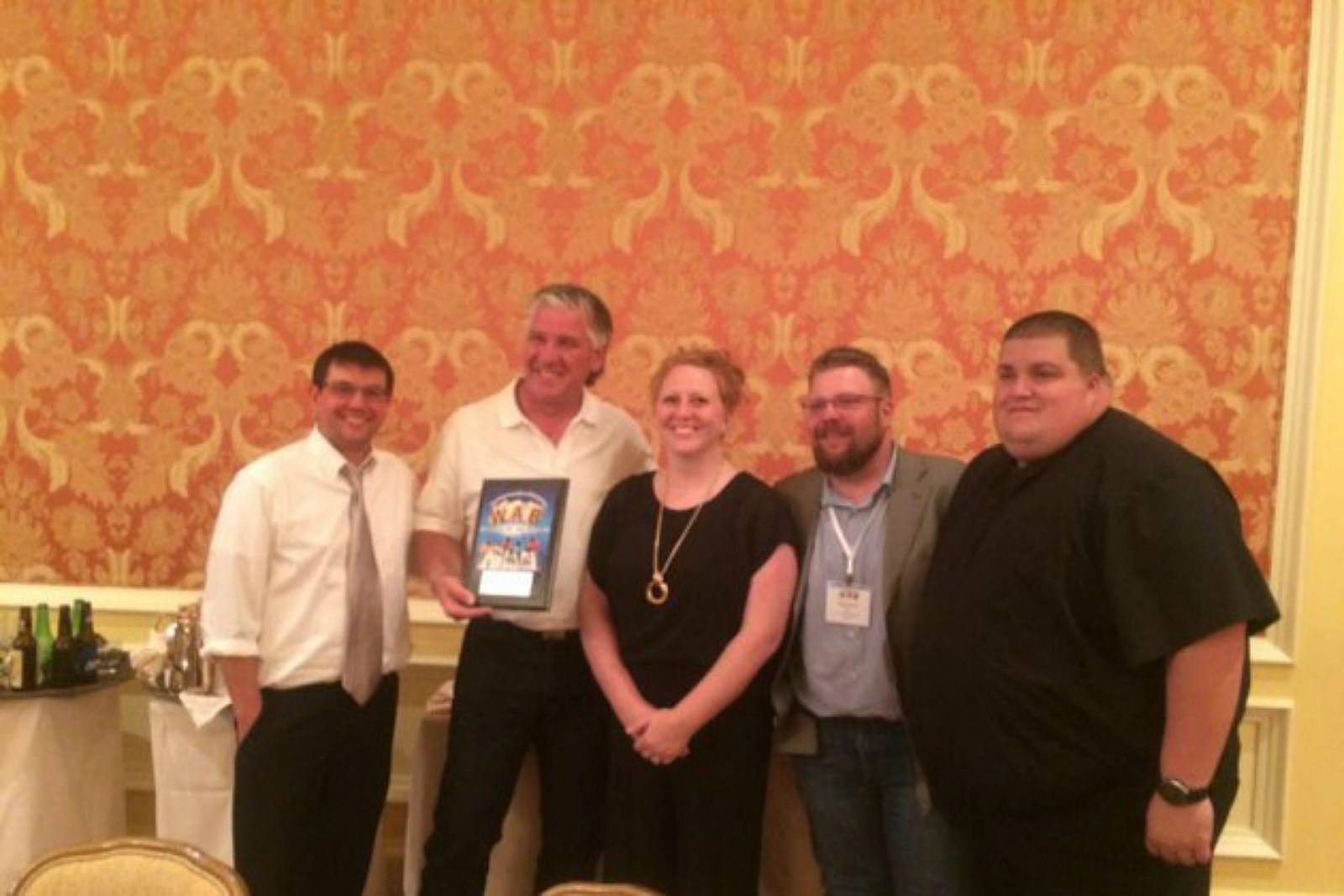 """Jerrad Anderson, Brian """"Alf"""" Grzegorczyk, Leslie Hill, Donovan Short and Rob Roberts pose with the Wyoming Association of Broadcasters Award for """"Best Public Service""""."""